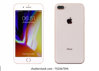 New York, USA - October 20, 2017: Brand new gold Apple iPhone 8 plus front and back side isolate on  white background with clipping path.