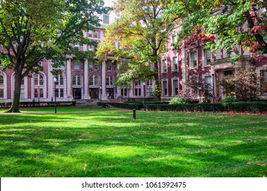 NEW YORK, USA - OCTOBER, 2015: Red brick Columbia university campus building in shades of colorful trees