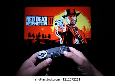 New York, USA - October 26, 2018: Red Dead Redemption 2 is a Western-themed action-adventure video game developed and published by Rockstar Games.