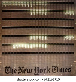New York, USA - October 26, 2012: The front view of the logo and outer wall facade of The New York Times Headquarter tower at night. Editorial Use Only.