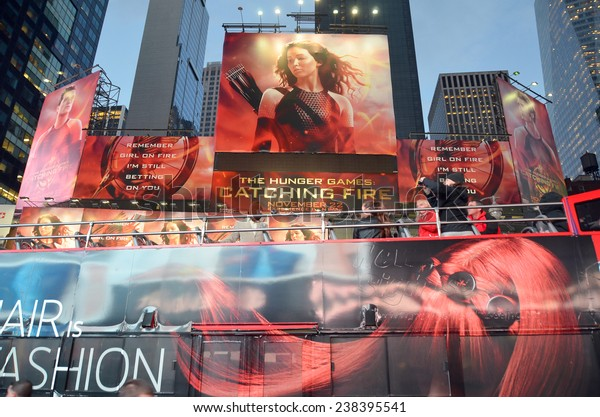 NEW YORK USA OCTOBER 27: Giant sign of The Hunger Games: Catching Fire movie in Time Square on October 27, 2013 in New York, Catching Fire, the second installment in The Hunger Games trilogy