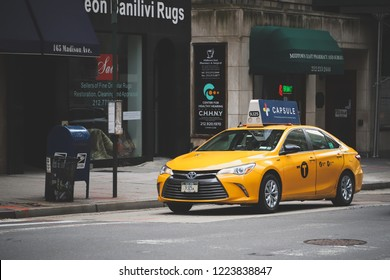 NEW YORK, USA - OCTOBER 28, 2018: NYC taxi car on 165 Madison Avenue in Midtown Manhattan, New York city