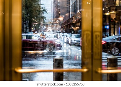 New York, USA - October 29, 2017: Grand central terminal entrance from Lexington Avenue in New York City NYC during rainy day from market looking outside through door window