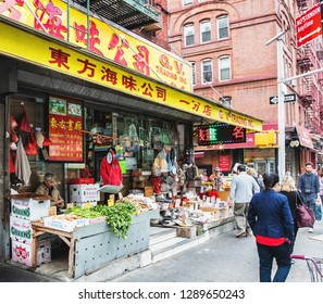 NEW YORK, USA - October 3, 2016 : Food and Vegetable markets at Chinatown on Mott Street in New York City