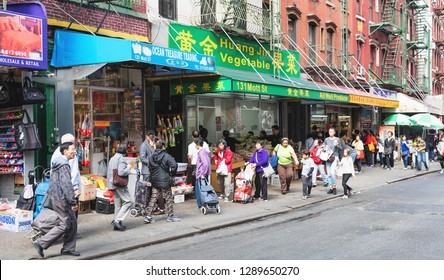 NEW YORK, USA - October 3, 2016 : Food, Fish and Vegetable markets at Chinatown on Mott Street in New York City