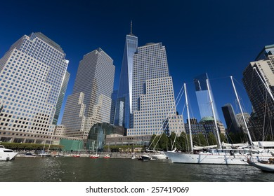 NEW YORK, USA - OCTOBER 5, 2014:Tall ships docked at the North Cove Marina at Battery Park in Manhattan and financial center panorama