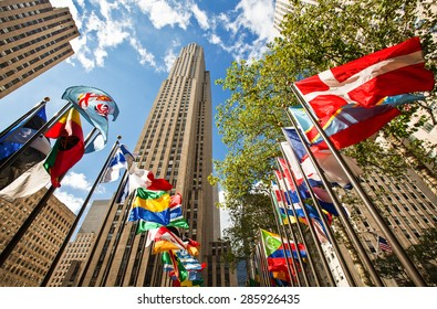 New York, U.S.A. - October 6 2010: Manhattan, buildings and flags in Rockefeller Center