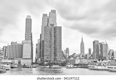 New York, USA - October 9, 2013: View of Manhattan in a cloudy day at Hudson shore in New York City on October 9, 2013.