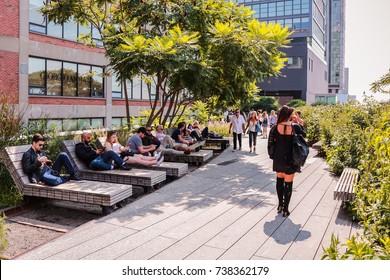 NEW YORK, USA - SEP 08, 2017: High Line Park Walk Path People Nature Green