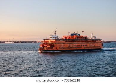 NEW YORK, USA - SEP 08, 2017: Manhattan South Ferry Boat Staten Island Sunset