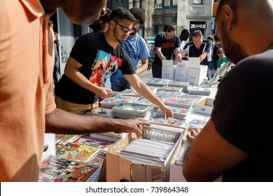 NEW YORK, USA - Sep 16, 2017: Street sale of comics in Manhattan in New York City. Young men choose comics