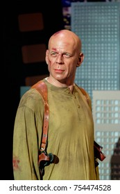 NEW YORK, USA - SEP 16, 2017: Bruce Willis as John McClane from Die Hard film, American actor, Madame Tussauds NY wax museum.