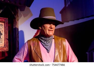 NEW YORK, USA - SEP 16, 2017: John Wayne,  an American actor and filmmaker, Madame Tussauds NY wax museum.