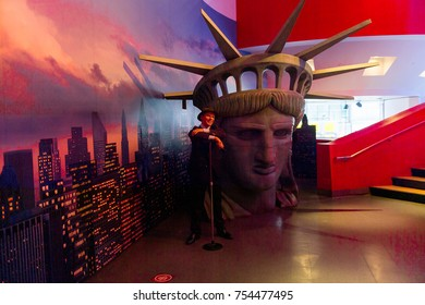 NEW YORK, USA - SEP 16, 2017: Frank Sinatra and the Head of the Statue of Liberty, Madame Tussauds NY wax museum.