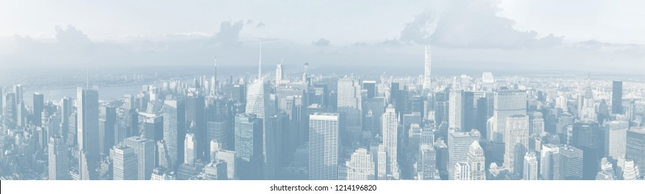 NEW YORK, USA - Sep 17, 2017: Streets and roofs of Manhattan. Panoramic image in light blue tonality. New York City Manhattan midtown viewed from top of Empire State Building. Birds eye view