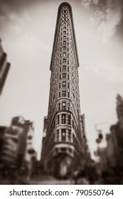 NEW YORK, USA - Sep 17, 2017: Flatiron Building in New York City. Old photo stylization, film grain added. Sepia toned. Vintage, retro style