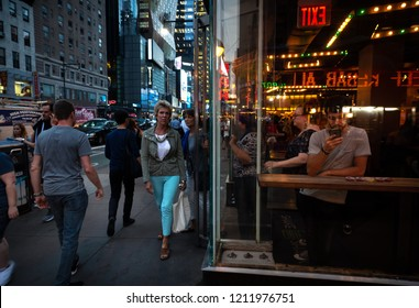 New York, USA - Sep 20, 2016: New York and New Yorkers. Manhattan street scene. The Americans on the streets of New York City in evening time
