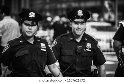 NEW YORK, USA - Sep 21, 2017: Police officers performing his duties on the streets of Manhattan. New York City Police Department (NYPD) is the largest municipal police force in the United States