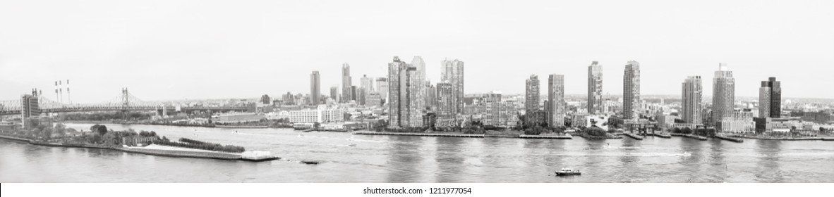 NEW YORK, USA - Sep 21, 2016: Panoramic views of East River from United Nations Building. Ed Koch Queensboro Bridge, Franklin D Roosevelt Four Freedoms Park, Hunters Point and Long Island City YMCA