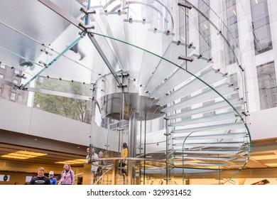 NEW YORK, USA - SEP 22, 2015: Glass stairs at the Apple store on the Fifth Avenue, New York. The store sells Macintosh personal computers, software, iPod, iPad, iPhone, Apple Watch, Apple TV