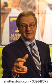 NEW YORK, USA - SEP 22, 2015: Jerry Springer in Madame Tussaud  wax museum, TImes Square, New York City. Marie Tussaud was born as Marie Grosholtz in 1761
