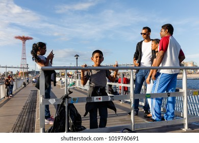 NEW YORK, USA - Sep 23, 2017: Peoples on Steeplechase Pier on Coney Island Beach in New York City. Coney Island is well known as the site of amusement parks and a seaside resort