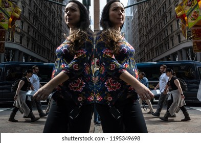 New York, USA - Sep 24, 2018: Manhattan reflections street scene. New York and New Yorkers reflected in the glass windows of shops and buildings.