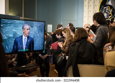 NEW YORK, USA - Sep 28, 2015: Journalists in the lobbies of UN listen to a speech by US President Barack Obama at the opening of the 70th session of the UN General Assembly in New York