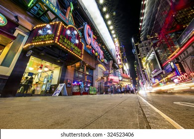 NEW YORK, USA - Sept 18th, 2015: Times Square and 42nd Street is a busy tourist intersection of neon art and commerce and is an iconic street of New York and America