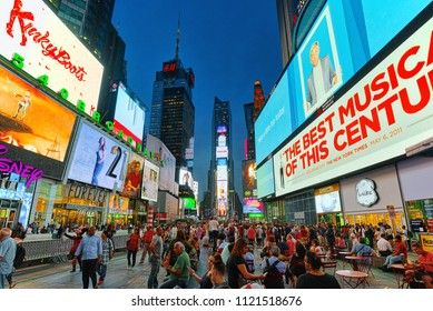 New York, USA- September 06, 2017 : Night view of Times Square-central and main square of New York. Street, cars, people and tourists on it.