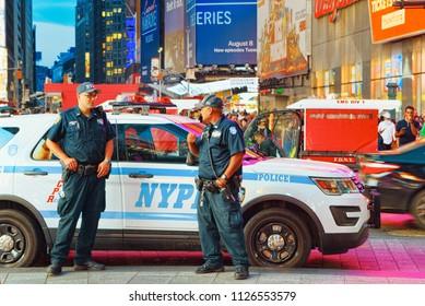 New York, USA- September 06, 2017 : Policeman and police car of New York. Financial capital of America is New York City.
