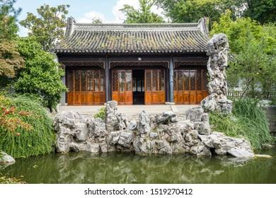 New York / USA - September 13 2019: New York Chinese Scholar's Garden with pond