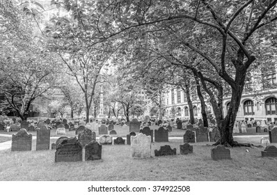 NEW YORK, USA - SEPTEMBER 13, 2015: Black and white picture of gravestones in Trinity Church Cemetery, located at 74 Trinity Place at Wall Street and Broadway.