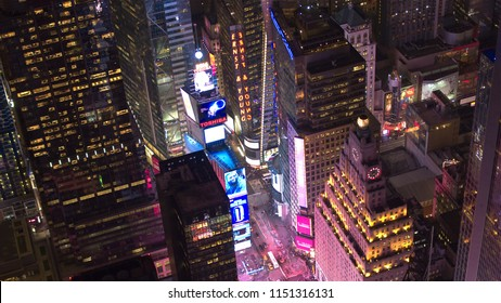 NEW YORK USA - SEPTEMBER 23 2016: brightly lit Paramount Building on color flashy Times Square in New York City. Busy intersection of art and commerce with electric, neon and illuminated signs