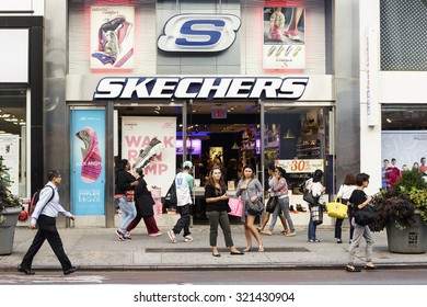 New York, New York, USA - September 23, 2015: People walking by a Skechers store on 34th street in Manttan. Skechers is a manufacture and retailer of footwear.