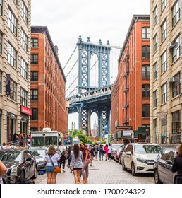 NEW YORK, USA - September 24, 2018: DUMBO district in Brooklyn. Dumbo is a neighborhood in the New York City borough of Brooklyn. Red buildings and Manhattan Bridge.