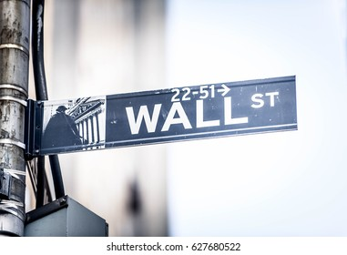 NEW YORK, USA - SEPTEMBER 25, 2016:Wall Street sign hanging on a pole, New York. Wall Street is the financial centre of Manhattan and the most important in the USA.