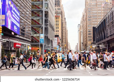 NEW YORK, USA - September 26, 2018: Peoples in Times Square. Manhattan, New York. Crowds and college of neon lights, street signs and advertisements at Times Square.