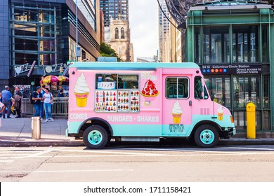 NEW YORK, USA - September 26, 2018: Pink and blue Ice Cream Truck on streets of Manhattan. Cones, Sundaes, Ice-cream and Shakes seller.