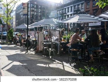 New York, New York, USA - September 26, 2020: Outdoor dining during the pandemic. People can be seen.