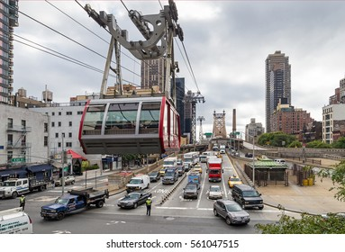 NEW YORK, USA - SEPTEMBER 26, 2013: traffic on East 60th Street of Manhattan and Queensboro Bridge and aerial tramway tower, New York City
