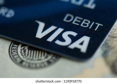 New york, USA - september 27, 2018: Debit visa electronic card on dollar banknote background