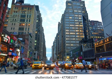 NEW YORK, USA - SEPTEMBER 28, 2015. Street view on 8th Avenue in New York, with buildings, skyscrapers, commercial properties, street traffic and blurred figures of people.