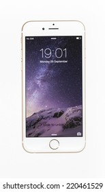 New York, USA - September 29, 2014: Studio shot of a white iPhone 6 showing the home screen with iOS8. Isolated on white.