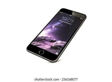 New York, USA - September 29, 2014: Front view of a space grey color iPhone 6 showing the home screen with iOS8. Isolated on white.