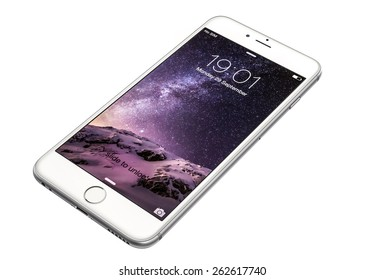 New York, USA - September 29, 2014: Studio shot of a silver-white colored iPhone 6 showing the home screen with iOS8. Isolated on white.