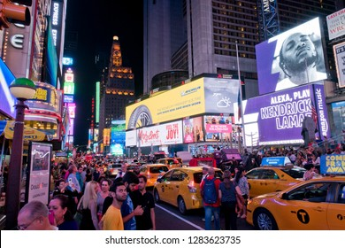 New York, USA - September 2nd, 2018 Large crowd of people on Times Square with yellow cabs stuck in traffic on Labor Day Weekend.