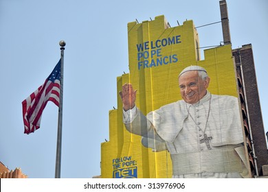New York, USA - September 3, 2015: Giant outdoor mural greets visitors and locals in New York City dedicated to the Pope's visit in 2015