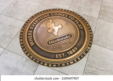 NEW YORK, USA - SEPTEMBER 4TH 2019: Golden plate with Mario at the entrance of the Nintendo Store. Located in 10 Rockefeller Plaza, at Rockefeller Center in New York City.