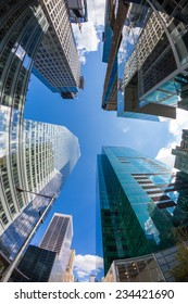 NEW YORK, USA - SEPTEMBER 7, 2014: Modern Skyscrapers in downtown, financial district. Low angle view with fish-eye lens.